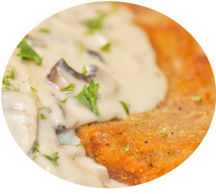 Breaded Chicken Escolope with a garlic and mushroom cream sauce.