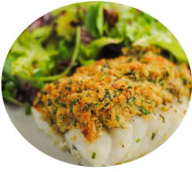 Oven baked cod coated with basil, dill & chives with a prawn, white wine & cream sauce.